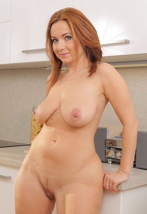 image Sexy latina red head milf having fun with a cock